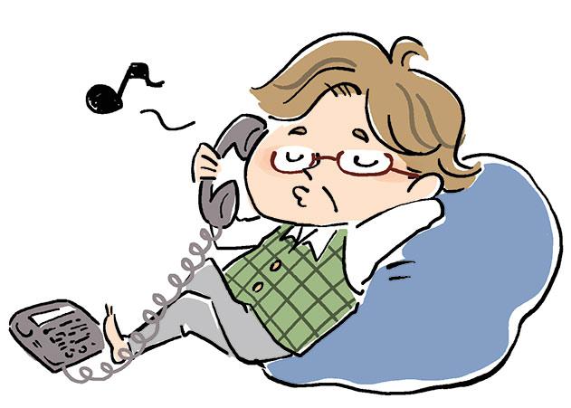 寝ながら電話する男性